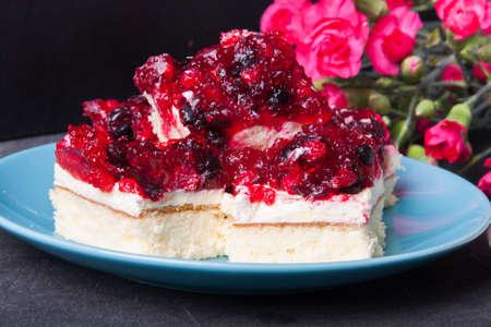 Stack of forest fruit cake with jelly and cream on a plate Stock Photo