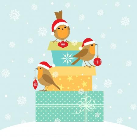 Robins met Kerst decoratie op geschenkdozen.