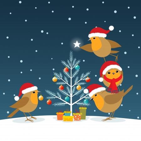 Robins wearing Santa Claus hats decorating Christmas tree.