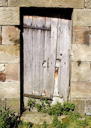 old weathered wooden farmhouse/ barn door Stock Photo - 1976300