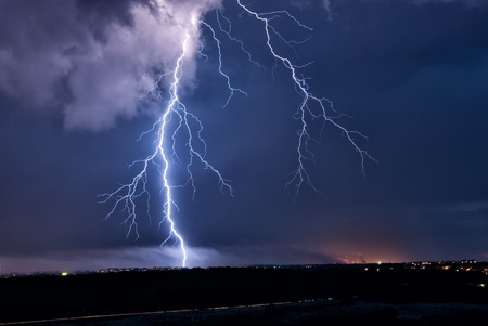 thundershower: The big lightning during a thunder-storm over a city Stock Photo