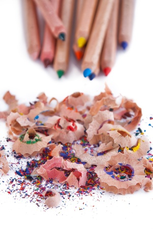 Multi-coloured pencil with crayon shavings, on white background Stock Photo - 12434792