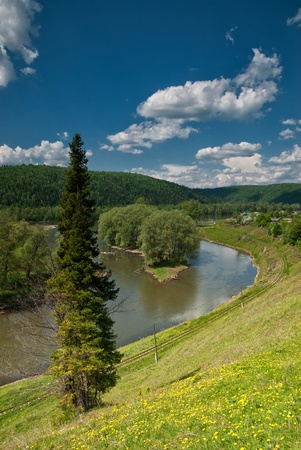 Beautiful summer landscape with river, mountain and sky photo