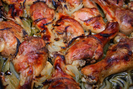 Fresh ripe roasted chicken legs on barbecue pan Stock Photo - 12435046