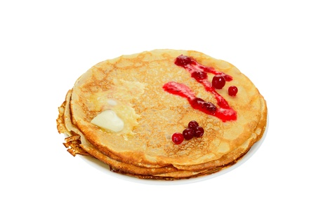 Russian pancake with cranberry and melting butter, isolated on white background photo