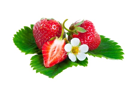 Whole and half strawberries on green leaves with flower isolated on white background photo