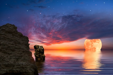 Colourful landscape with big moon and rock at the ocean, sky reflected in water