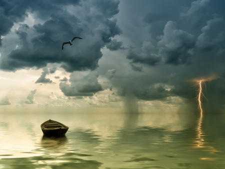 The lonely old boat at the ocean, comes nearer a thunder-storm with rain and lightning on background Stock Photo