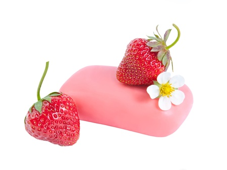Natural soap with a strawberry and flower isolated on white background photo