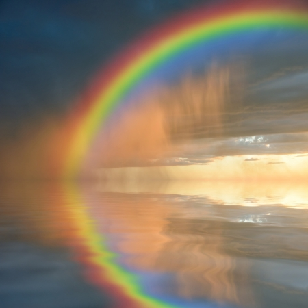rainbow colours: Colorful rainbow over water, thunderstorm with rain on background