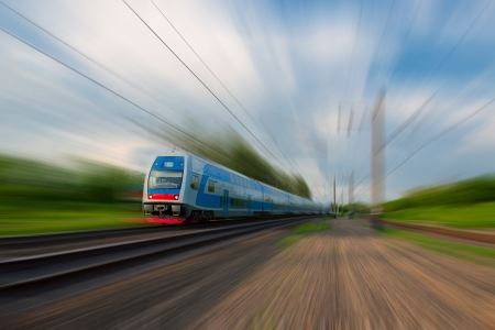 High-speed commuter train with motion blur photo