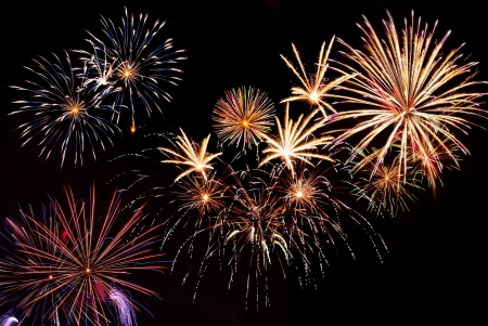 fireworks background: Beautiful colorful holiday fireworks on the black sky background,long exposure   Stock Photo