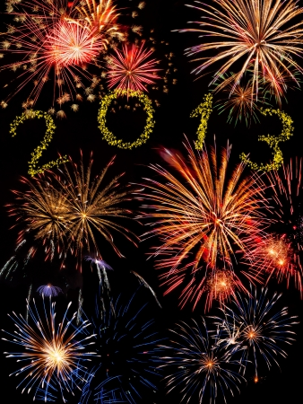 Beautiful colorful 2013 new year fireworks on the black sky background Foto de archivo