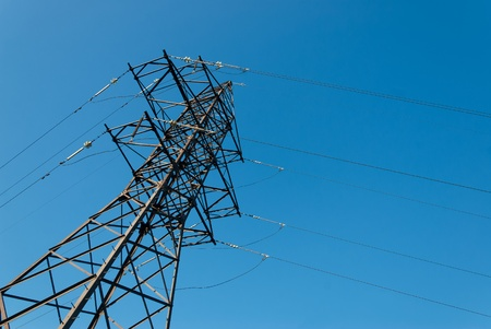 Electricity high-voltage tower on blue sky background photo