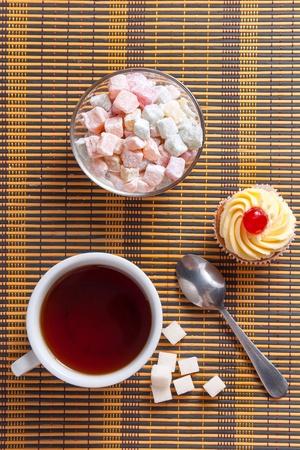 locum: Tea, fresh cherry muffin, colorful delight and sugar