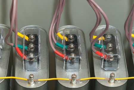 Close up high-voltage capacitors with wires in installation of automatic compensation of jet capacity photo