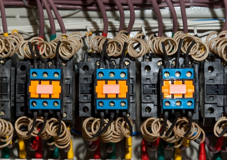 Close up actuators and wire in control panel photo