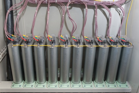 High-voltage capacitors with wires, installation of automatic compensation of jet capacity photo