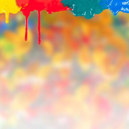 Abstract paints dripping on colorful background photo