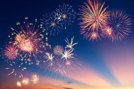 Beautiful colorful holiday fireworks in the evening sky with majestic clouds,  long exposure Stock Photo - 16614487