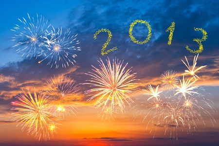 Beautiful colorful New Year 2013 fireworks in the evening sky with majestic clouds, long exposure Stock Photo - 16648753