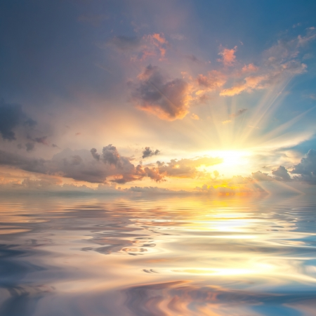 beach sunrise: Beautiful sunset over sea with reflection in water, majestic clouds in the sky