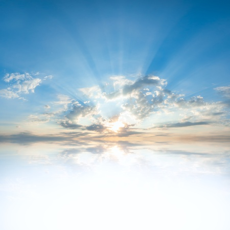 clouds and skies: Blue sky with clouds and sun reflection in water with place for your text