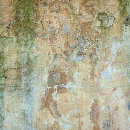 Background texture of the old cracked wall with peeling paint and plaster, for design photo