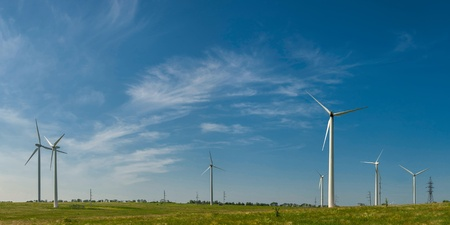 Landscape with windmills on field, alternative energy, panorama photo