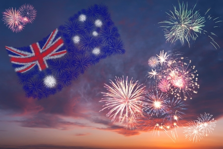 Beautiful colorful holiday fireworks with national flag of Australia, evening sky with majestic clouds Stock Photo
