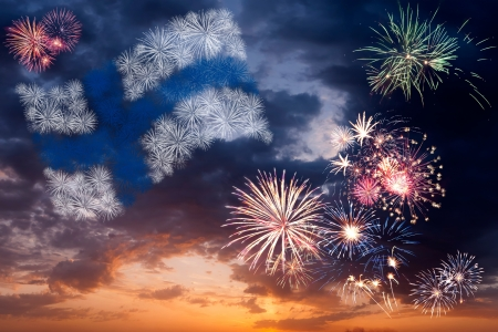 Beautiful colorful holiday fireworks with national flag of Finland, evening sky with majestic clouds Фото со стока