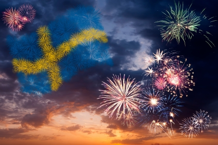 Beautiful colorful holiday fireworks with national flag of Sweden, evening sky with majestic clouds photo