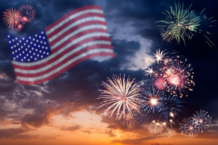 Beautiful colorful holiday fireworks with national flag of USA, evening sky with majestic clouds