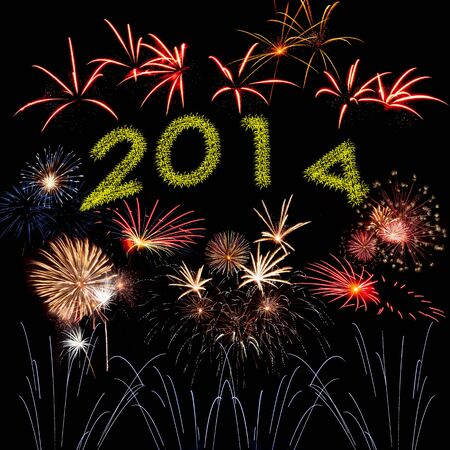 Beautiful New Year holiday fireworks on the black sky background photo