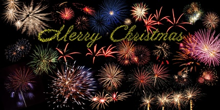 Beautiful Merry Christmas banner with fireworks on the black sky photo
