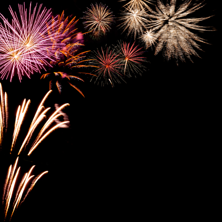 Beautiful Christmas fireworks on the black background, place for your text Stock Photo - 23840112
