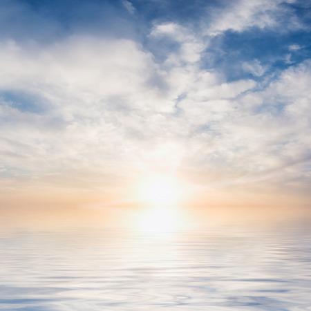 Sun in sky reflection in water
