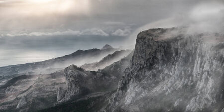 surrealistic: Surrealistic mountain landscape with peaks in mist Stock Photo