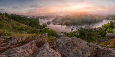 Beautiful sunrise with fog on the river, nature landscape photo