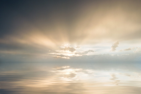 Majestic sunset over sea, cloud reflection in water photo
