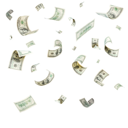 cash on hand: Rain from falling dollars isolated on white background Stock Photo