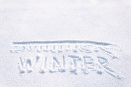 strikethrough: WINTER written by the finger in the snow, SUMMER strikethrough