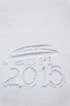 tachado: 2015 escrito por el dedo en la nieve, 2014 tachado Foto de archivo