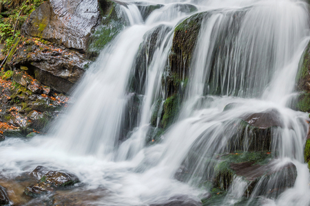 jets: Beautiful autumn waterfall with white jets Stock Photo