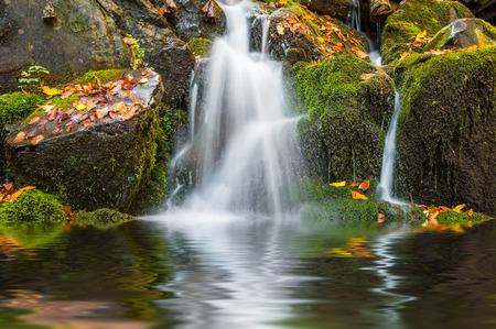 water reflection: Beautiful autmn waterfall reflection in lake, landscape Stock Photo