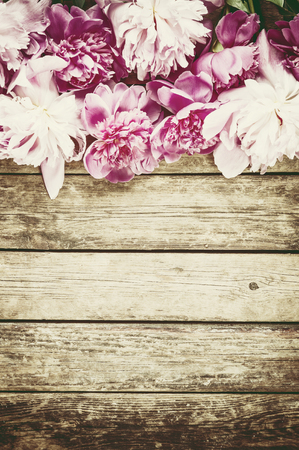solemnity: Vintage background with peony flowers in rustic style Stock Photo