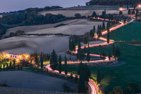 italian landscape: Evening landscapes of Tuscany with traces of car headlights