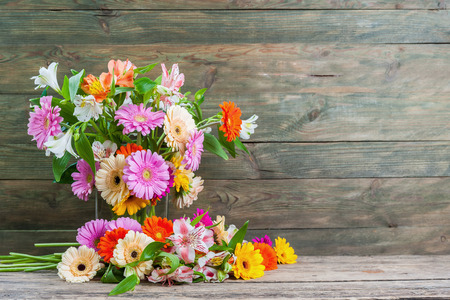 gebera: Nature rustic background with alstroemeria and gebera flowers, selective focus