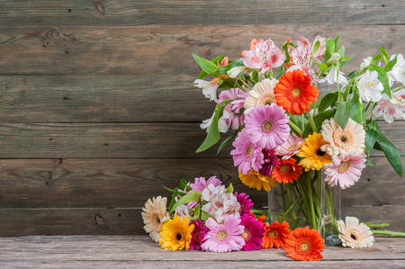 Fresh gerbera flowers on wooden background, flower border, floral background with place for text Фото со стока