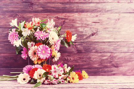 gebera: Vintage rustic background with alstroemeria and gebera flowers, selective focus